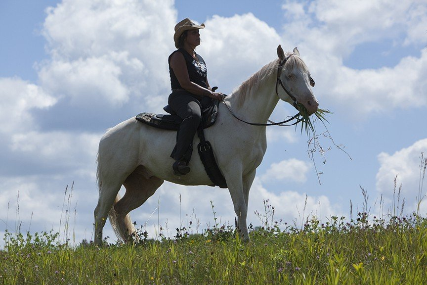 Winona LaDuke and Honor the Earth hold their 4th annual spiritual horse ride against the current of oil as her Ojibwe community is facing new Enbridge pipelines which threaten the sacred wild rice beds of Northern Minnesota. Winona LaDuke, Executive Director of Honor the Earth, embarks on a horse ride against the proposed Enbridge Sandpiper pipeline. Along the way the riders will raise awareness of the proposed pipeline by informing native communities and landowners of the inherent risks of the project and their rights to oppose it. The ride traverses the Sandy Lake and Rice Lake watersheds, a mother lode of wild rice in Minnesota. The proposed pipeline would threaten traditional wild rice beds from East to West. Photo by Keri Pickett.